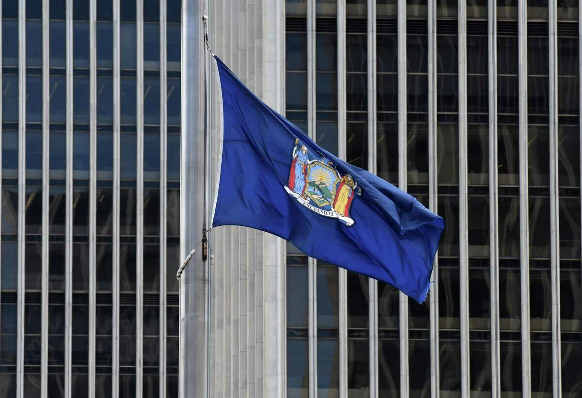The New York State flag at Empire State Plaza is flown at half-staff during the coronavirus lockdown on Thursday, May, 14, 2020, in Albany, N.Y. (Will Waldron/Times Union)
