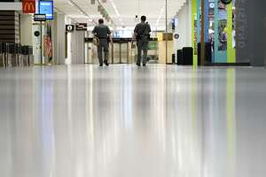 New York State troopers walk through a near-empty Empire State Plaza Concourse during the coronavirus lockdown on Thursday, May, 14, 2020, in Albany, N.Y. (Will Waldron/Times Union)