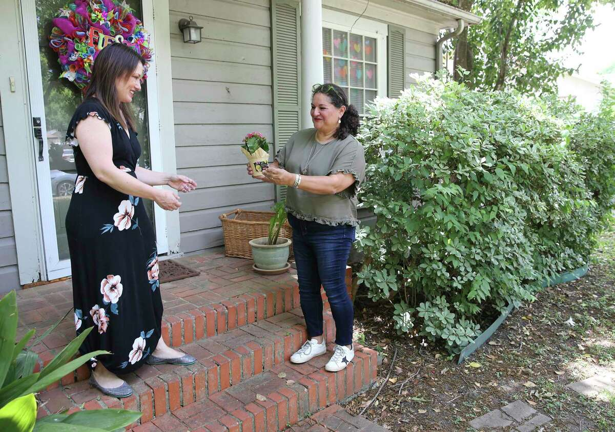 Debbie Alcoser, right, and Alisha Coyle belong to a Facebook group that helps folks give and take free household items. The group has grown in popularity as a way of connecting with neighbors during the coronavirus pandemic.