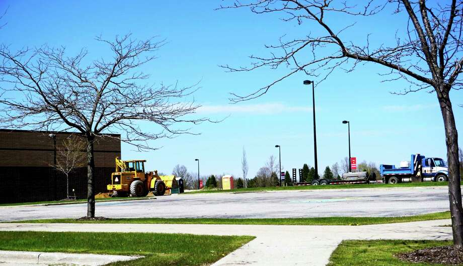 Construction crews work on the new auxiliary gymnasium and prepare for renovations at the tennis courts at Big Rapids High School. (Pioneer photos/Joe Judd)