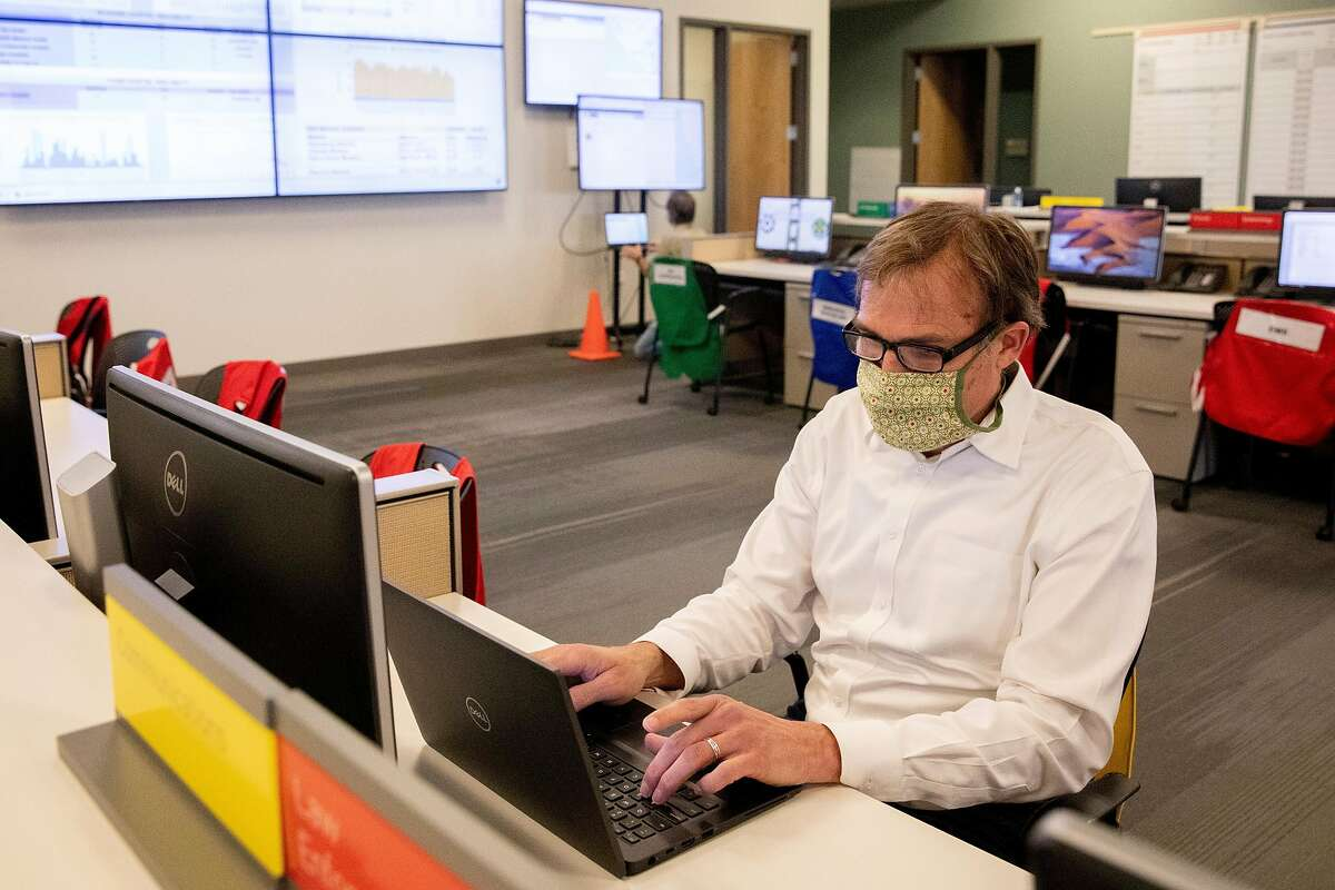 Marin County Health Officer Dr. Matthew Willis works inside the operations center at the Marin County Office of Emergency Services in San Rafael, Calif. Saturday, May 2, 2020. Willis recently recovered from a long battle with Coronavirus and is back to work.