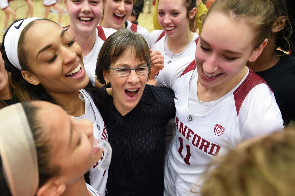 PALO ALTO, CA - JANUARY 20: The Setsuko Ishiyama Director of Womens Basketball Tara Vanderveer, who notched her 900th win at Stanford, celebrates with her players including Stanford Guard Dijonai Carrington (21), left, and Stanford Forward Alanna Smith (11), who scored a career high in points, during the women's basketball game between the Washington State Cougars and the Stanford Cardinal at Maples Pavilion on January 20, 2019 in Palo Alto, CA.