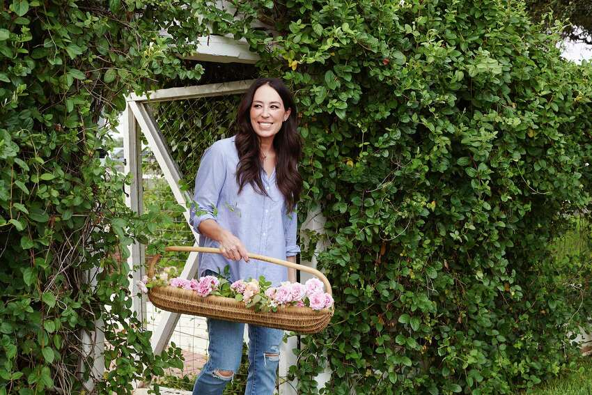 In an undated image provided by Amy Neunsinger, Joanna Gaines in her garden. She and her husband, Chip, the co-stars of a€œFixer Upper,a€ have married Texas tradition with modern taste to create a wildly popular brand. (Amy Neunsinger via The New York Times) -- NO SALES; FOR EDITORIAL USE ONLY WITH NYT STORY HOME POWER COUPLE BY JULIA MOSKIN FOR MAY 4, 2020. ALL OTHER USE PROHIBITED. --
