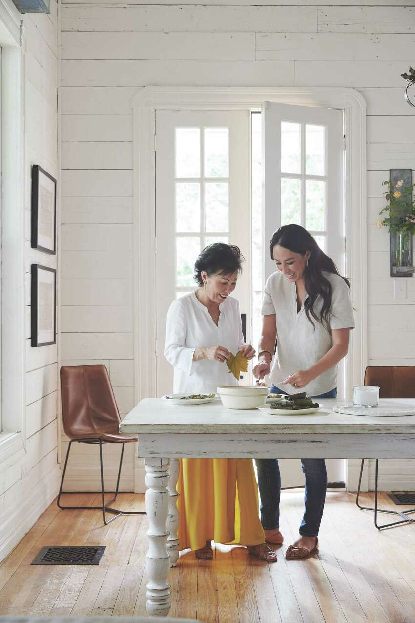 In an undated image provided by Amy Neunsinger, Joanna Gaines, right, and her mother, Nan, stuff grape leaves. Gainesa€™s mother left Korea when she was 19 to marry her father, Jerry, an American serviceman. (Amy Neunsinger via The New York Times) -- NO SALES; FOR EDITORIAL USE ONLY WITH NYT STORY HOME POWER COUPLE BY JULIA MOSKIN FOR MAY 4, 2020. ALL OTHER USE PROHIBITED. --