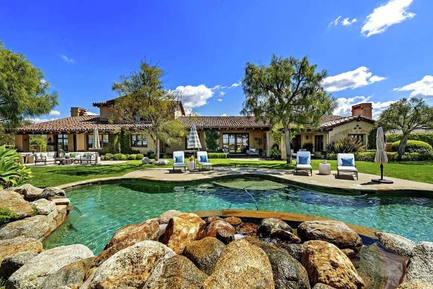 Former Chargers quarterback Philip Rivers is seeking $4.199 million for his Spanish-style estate in the Santaluz community of San Diego. The one-acre property sits behind gates and features a putting green, a resort-style swimming pool, lawn and golf course views. Built in 2005 and since updated, the single-story house has more than 6,800 square feet of living space with six bedrooms and 6.5 bathrooms. (Bowman Media Group)