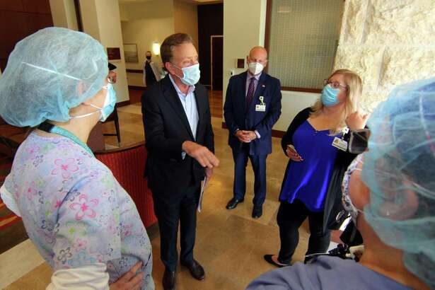 Gov. Ned Lamont speaks to staff during a visit to The Jewish Home senior services facility on Park Ave in Bridgeport, Conn., on Friday May 15, 2020.