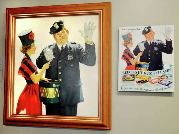 "Detail shot of an original oil canvas ""Beech-Nut Gum Girl and Policeman, 1939,"" by Norman Rockwell, at left, and at right, the Beech-Nut ad it inspired, on display at The Arkell Museum at Canajoharie.  (Luanne M. Ferris / Times Union) Photo: Luanne M. Ferris"
