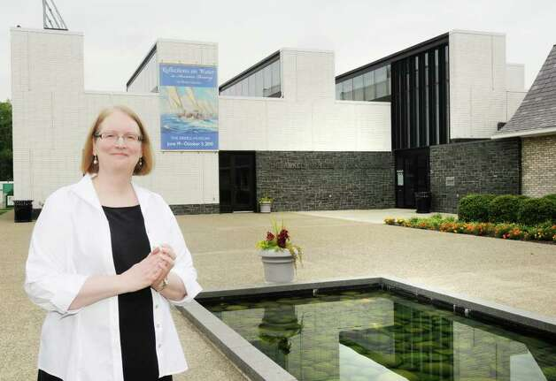 At left, Diane Forsberg, Deputy Director & Chief Curator, outside The Arkell Museum at Canajoharie, the library, and the reflecting pool. (Luanne M. Ferris/Times Union) Photo: Luanne M. Ferris