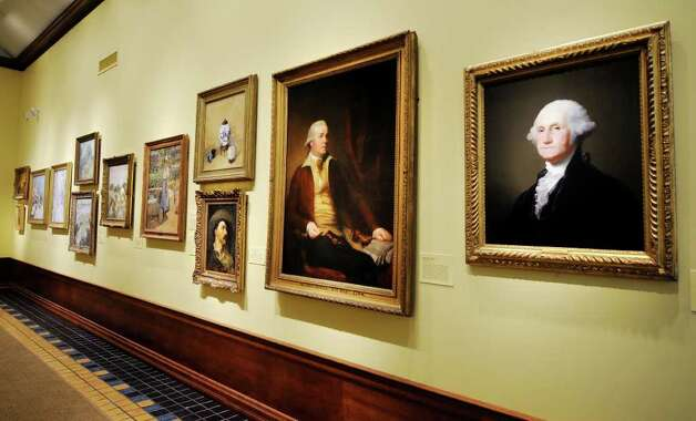 At right, a Gilbert Stuart oil on panel painting of George Washington, ca. 1820, leads the viewer down one of the walls in the original Arkell gallery at The Arkell Museum at Canajoharie.  (Luanne M. Ferris/Times Union) Photo: Luanne M. Ferris