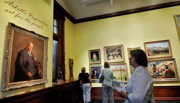 A portrait of Bartlett Arkell, the first president of Beech-Nut Packaging, welcomes visitors to the original Arkell gallery. (Luanne M. Ferris/Times Union) Photo: Luanne M. Ferris