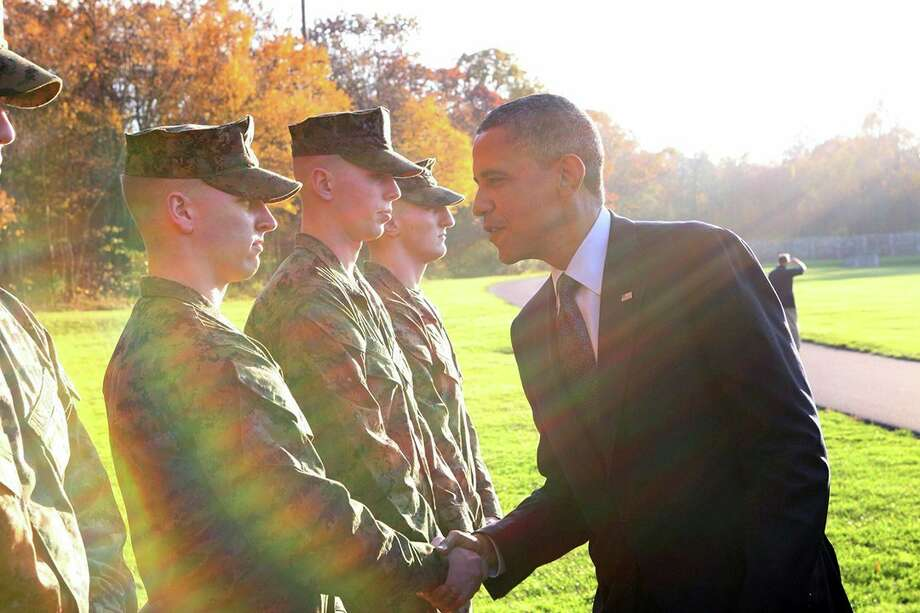 Chaz Fowler shakeshands with President Barack Obama at Camp David (Photo courtesy Chaz Fowler).