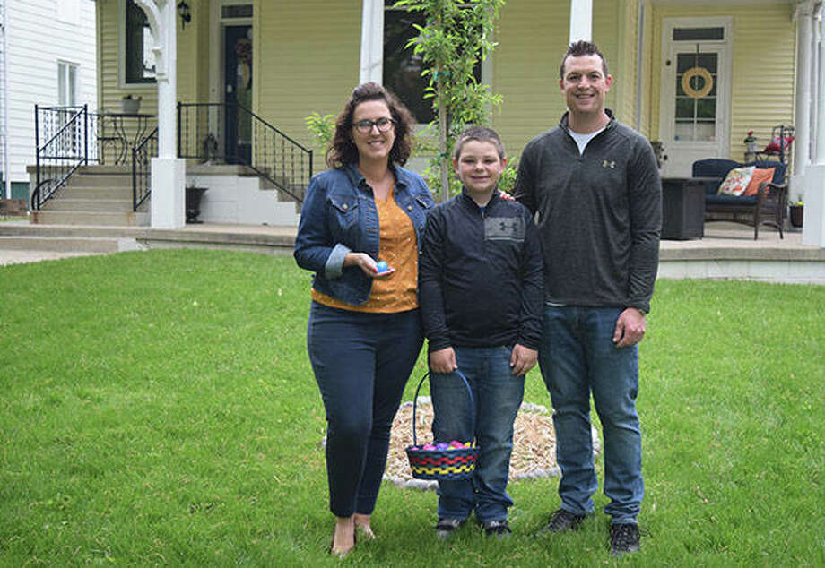 Cori (from left), Brayden and Brian Tobin loaned the use of their front porch for an Easter egg hunt. Cori and Brayden, 10, filled eggs with candy and invited anyone to visit and take an egg. Photo: Marco Cartolano | Journal-Courier