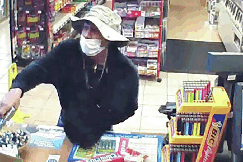 Surveillance video shows a man, believed to be William Rosario Lopez wearing a surgical mask, with a gun in a convenience store. Just how many criminals are taking advantage of the pandemic to commit crimes is impossible to estimate, but law enforcement officials have no doubt that the numbers are climbing. Reports are starting to pop up across the country, as well as in other parts of the world of crimes that were pulled off in no small part because so many of us are wearing masks. Photo: U.S. District Court | Via AP