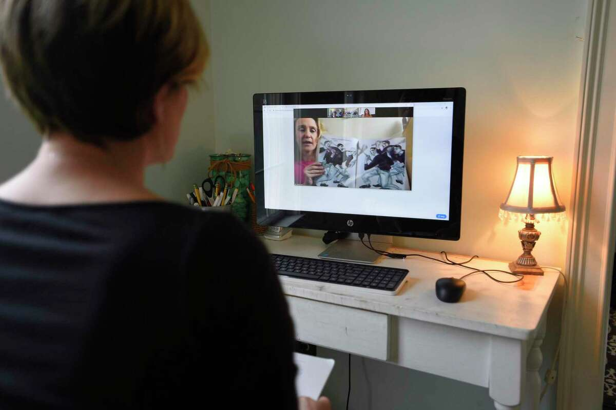Stamford teacher Stacey Wood video chats with fellow teachers Melissa Wall and Alex Frattaroli as they collaborate lesson plans for their students, from Wood's home in Fairfield, Connecticut on April 3, 2020. Stamford schools closed March 13 in response to the COVID-19 Pandemic adopting to a Distance Learning School Day lesson plan. Wood's has collaborated with fellow teachers using the Zoom virtual meeting platform to adopt lesson plans, read-a-louds and many other organizing and engaging activities for their students.