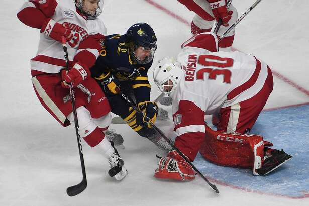 Sacred Heart goalie Josh Benson make a save on Quinnipiac's Nick Jermain in the second period of the championship game of the Connecticut Ice tournament at the Webster Bank Arena in Bridgeport in January.