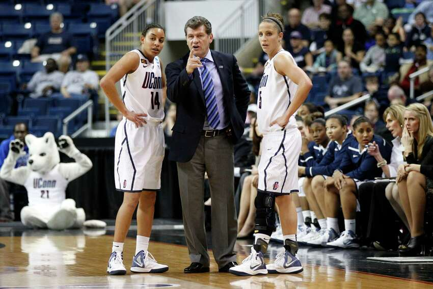 Mar 19, 2012; Bridgeport, CT, USA; Connecticut Huskies head coach Geno Auriemma talks with guard Bria Hartley (14) and guard Caroline Doty (5) during a break in the action against the Kansas State Wildcats during the first half in the second round of the 2012 NCAA women's basketball tournament at Arena at Harbor Yard. UConn defeated the Kansas State Wildcats 72-26. Mandatory Credit: David Butler II-US PRESSWIRE
