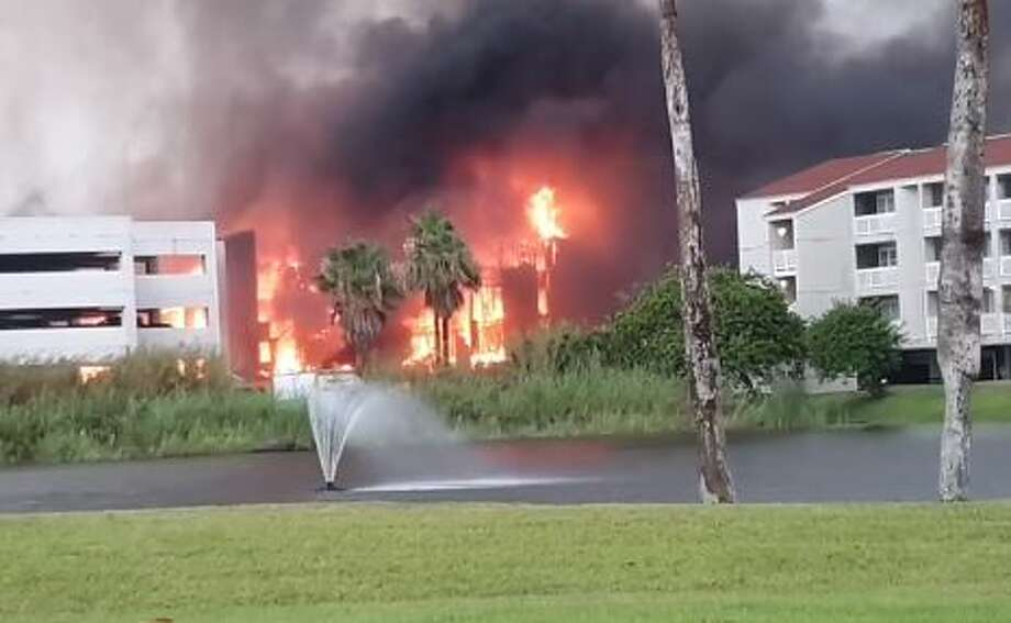 Firefighter rushed to contain a massive fire engulfing Gulf Point Condominiums building on South Padre Island, a Facebook video shows. Photo: Tommy Saenz/Facebook