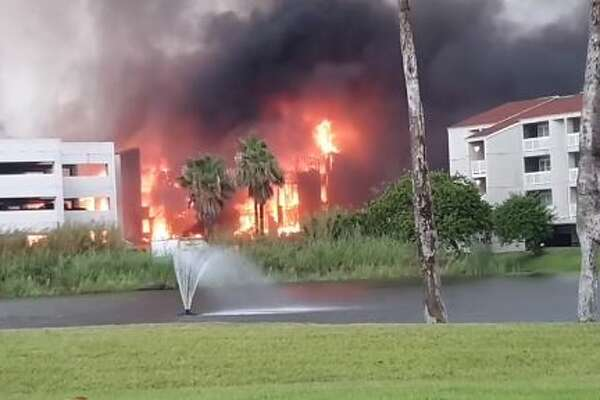 Firefighter rushed to contain a massive fire engulfing Gulf Point Condominiums building on South Padre Island, a Facebook video shows.