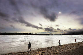 The area is into a steady pattern of scattered storms, common in the springtime, but that didn't stop about 25 people from trying their hand fishing in the Mississippi River just below the churning waters of the Melvin Price Locks and Dam 26.