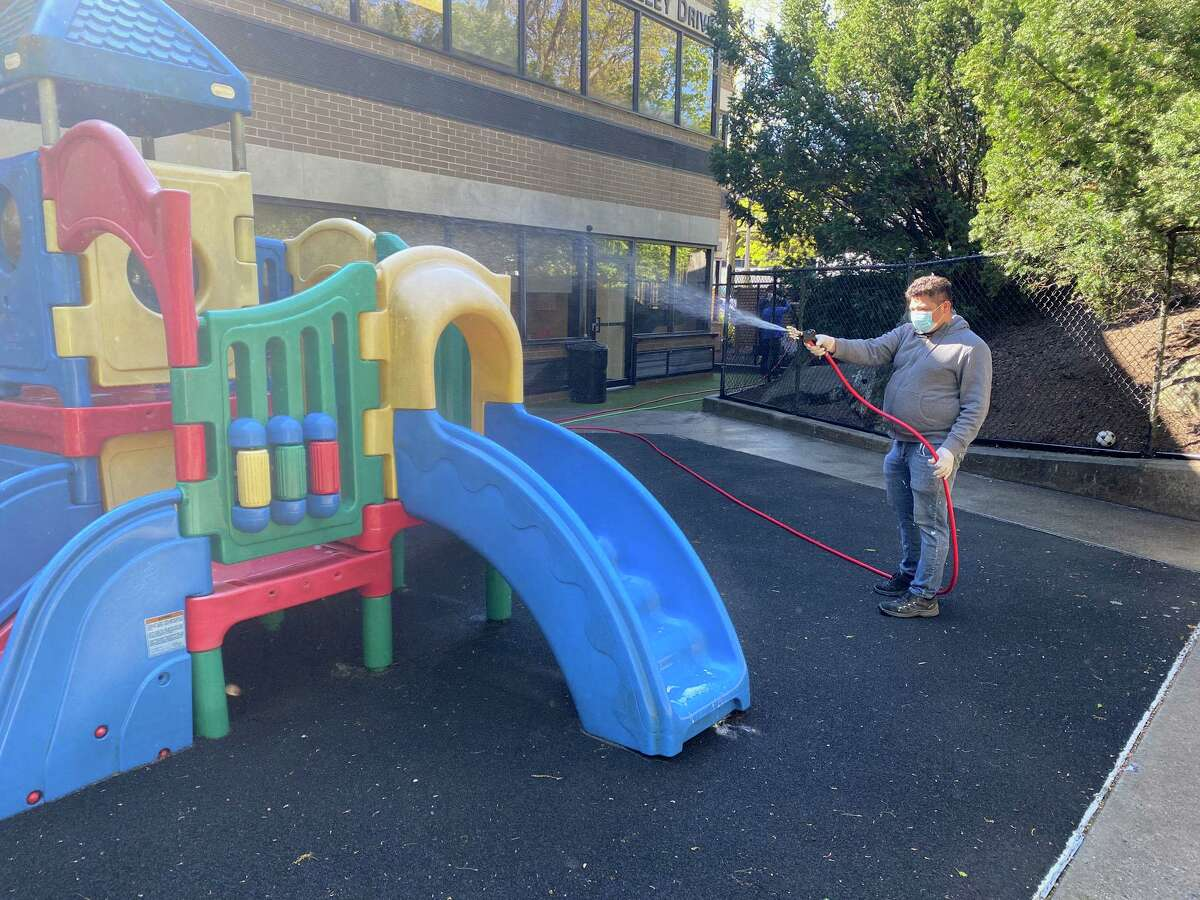 Greenwich-based Connecticut Gutter, LLC, is using a two-step power washing process to clean exterior surfaces where the coronavirus could linger, including on playground equipment.