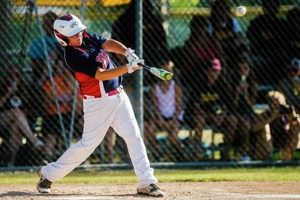 Fraternal Northwest's Max Reed takes a swing during a 2018 district tournament game.