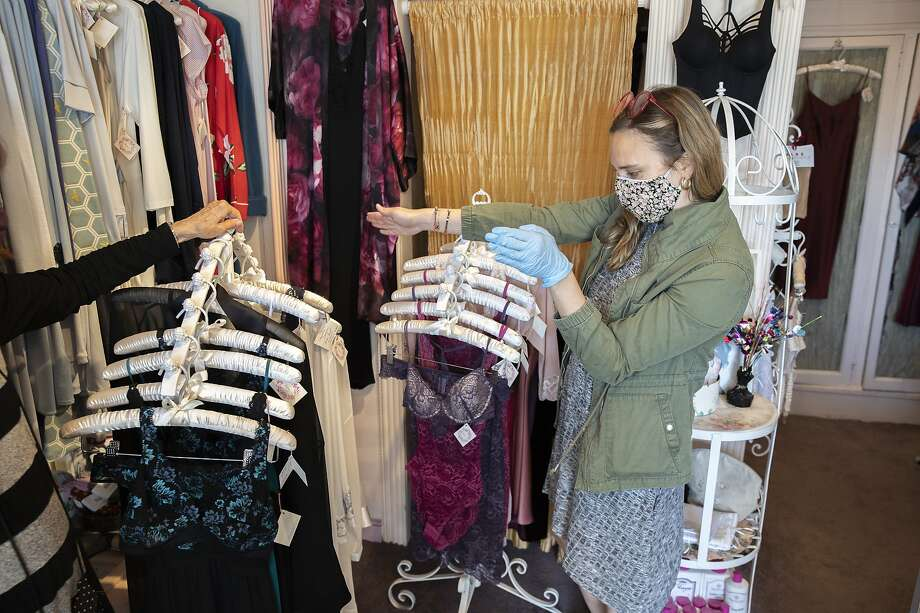 From left: Beverly Weinkauf and Katie Reisman prepare the shop at Toujours Lingerie on Friday, May 15, 2020, in San Francisco, Calif. Weinkauf, who owns the Fillmore district shop, prepared the place with her goddaughter Reisman to open on Monday after almost two months of shutdown orders due to the coronavirus pandemic. San Francisco on Monday will lift shutdown orders, allowing curbside pickups. Photo: Santiago Mejia / The Chronicle
