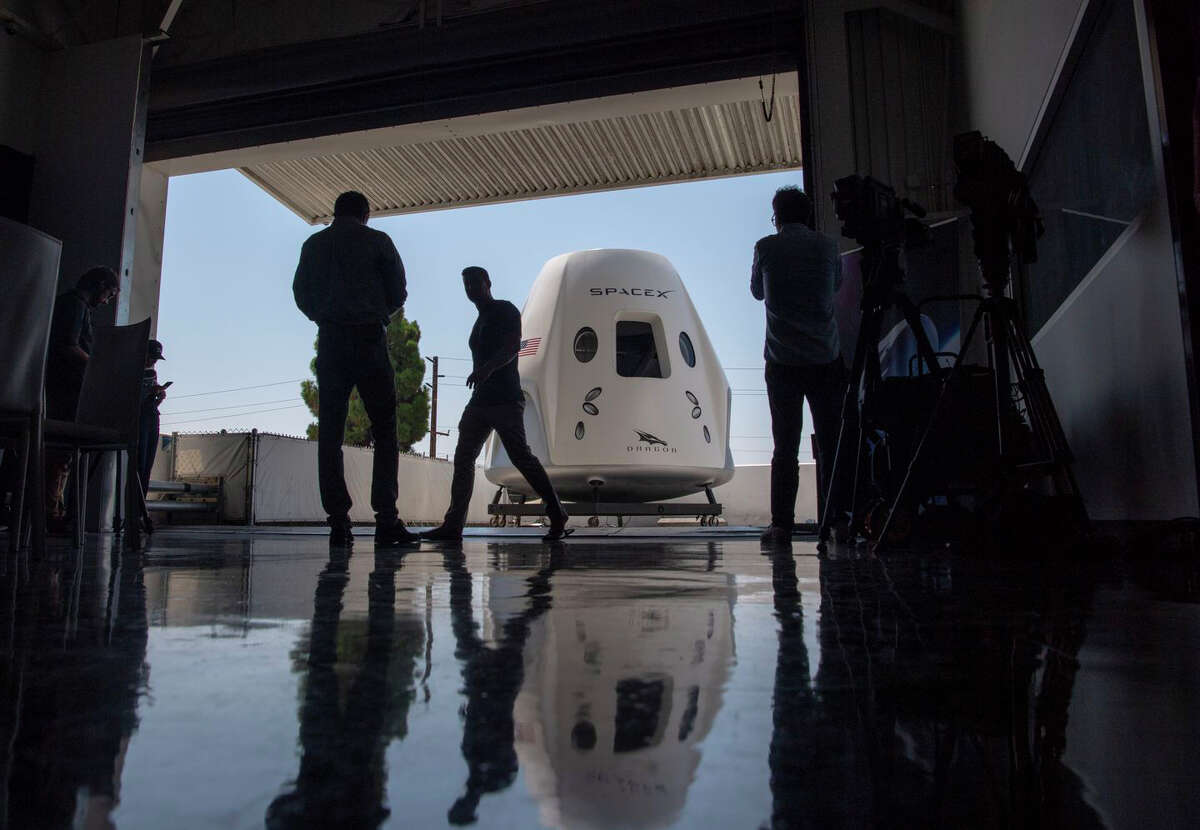 A mock-up of the SpaceX Dragon capsule for crew members is seen in 2018. Four years earlier, NASA awarded contracts to SpaceX and Boeing to ferry astronauts to the International Space Station. The first such SpaceX flight is set for later this month.