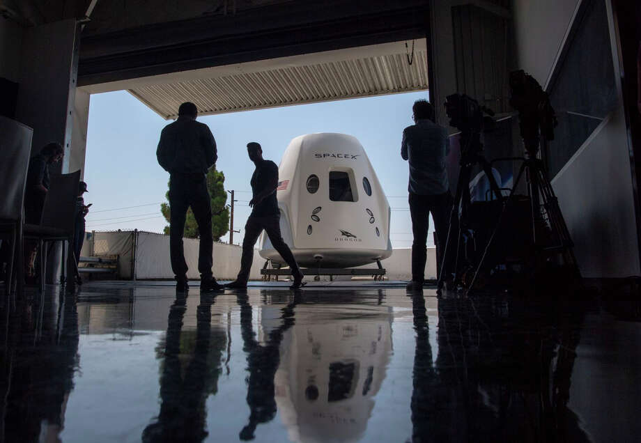 A mock-up of the SpaceX Dragon capsule for crew members is seen in 2018. Four years earlier, NASA awarded contracts to SpaceX and Boeing to ferry astronauts to the International Space Station. The first such SpaceX flight is set for later this month. Photo: Washington Post Photo By Jonathan Newton / The Washington Post