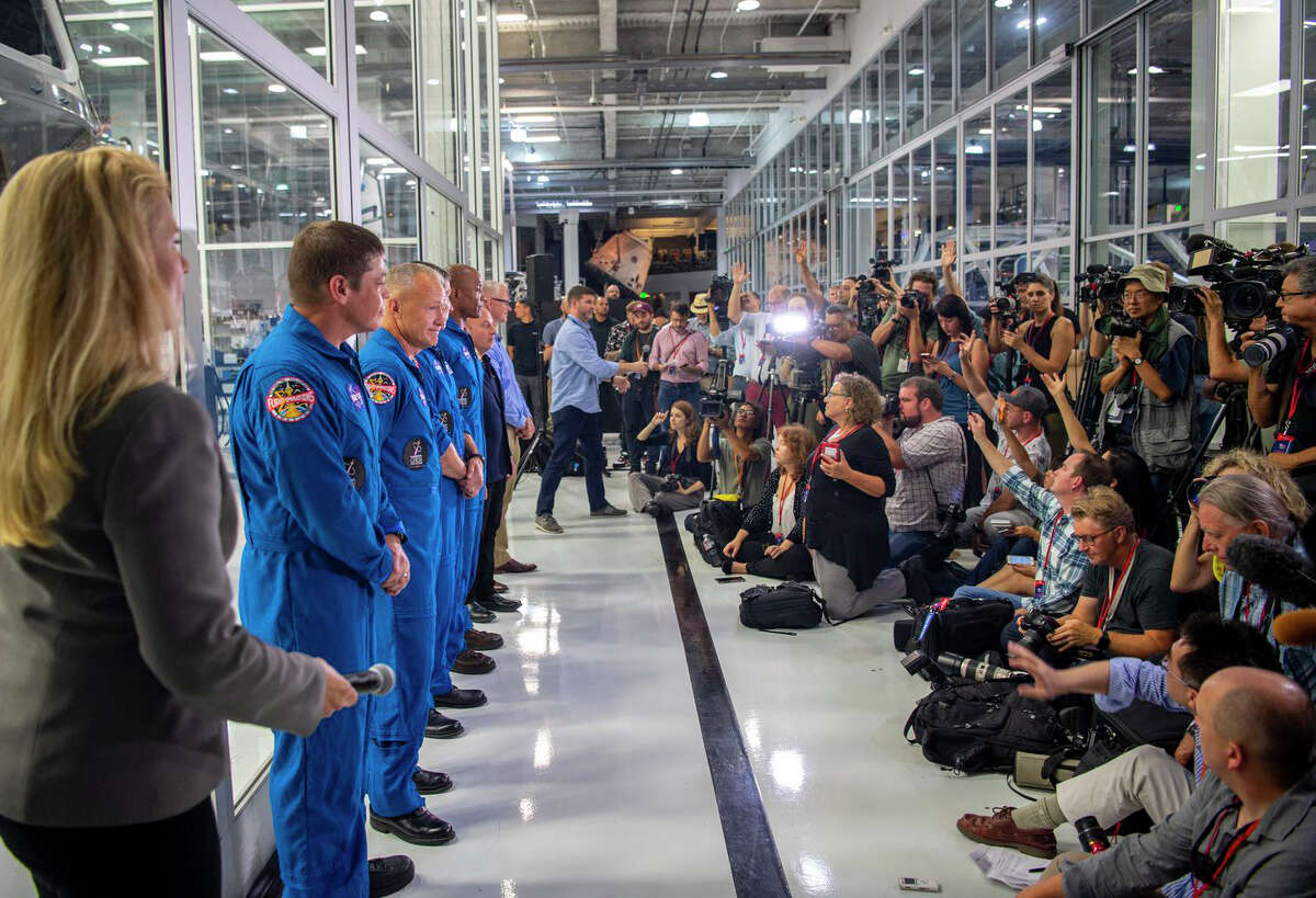 The first four astronauts assigned to SpaceX speak to the media in Hawthorne, California, in 2018.