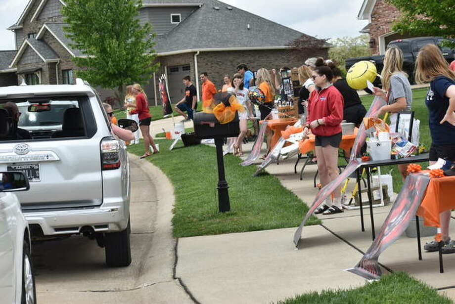The Edwardsville softball program hosted a parade Saturday to celebrate the outgoing senior class. Senior players set up in front of the house of a teammate and received gifts from underclassmen, coaches and parents. Photo: Matt Kamp|The Intelligencer