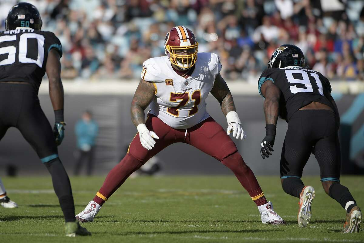 FILE - In this Dec. 16, 2018, file photo, Washington Redskins offensive tackle Trent Williams (71) sets up to block in front of Jacksonville Jaguars defensive end Yannick Ngakoue (91) during the second half of an NFL football game in Jacksonville, Fla. After sitting out last season in a dispute in Washington, seven-time Pro Bowl left tackle Trent Williams is excited to start over in San Francisco. (AP Photo/Phelan M. Ebenhack, File)