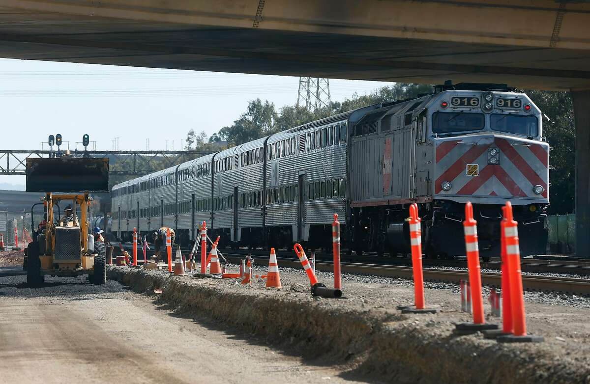 A northbound train makes a scheduled stop where the new Caltrain station is under construction in South San Francisco, Calif. on Wednesday, May 6, 2020. A developer hopes to break ground on a biotech project adjacent to the new station.