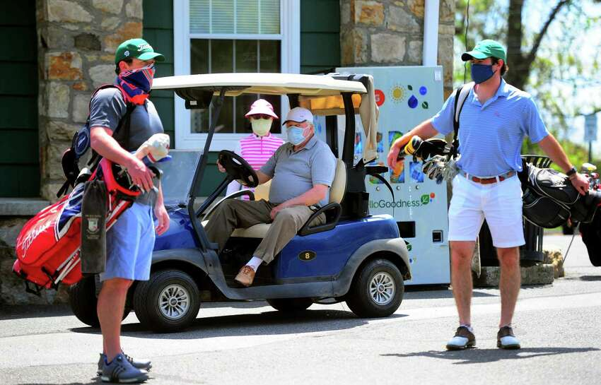 Golfers use social distancing as they wait to tee off at Fairchild Wheeler Golf Course in Bridgeport, Conn., on Saturday May 16, 2020. The course opened back up on Friday.