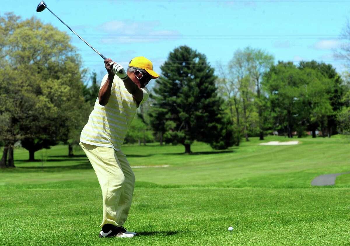 Golfer William Minor, of Bridgeport, plays a round at Fairchild Wheeler Golf Course in Bridgeport, Conn., on Saturday May 16, 2020.