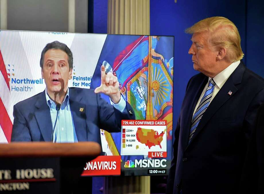 At the April 19 coronavirus briefing, President Trump shows video of New York Gov. Andrew Cuomo, a Democrat, thanking his administration for its assistance to his state. Photo: Washington Post Photo By Bill O'Leary / The Washington Post