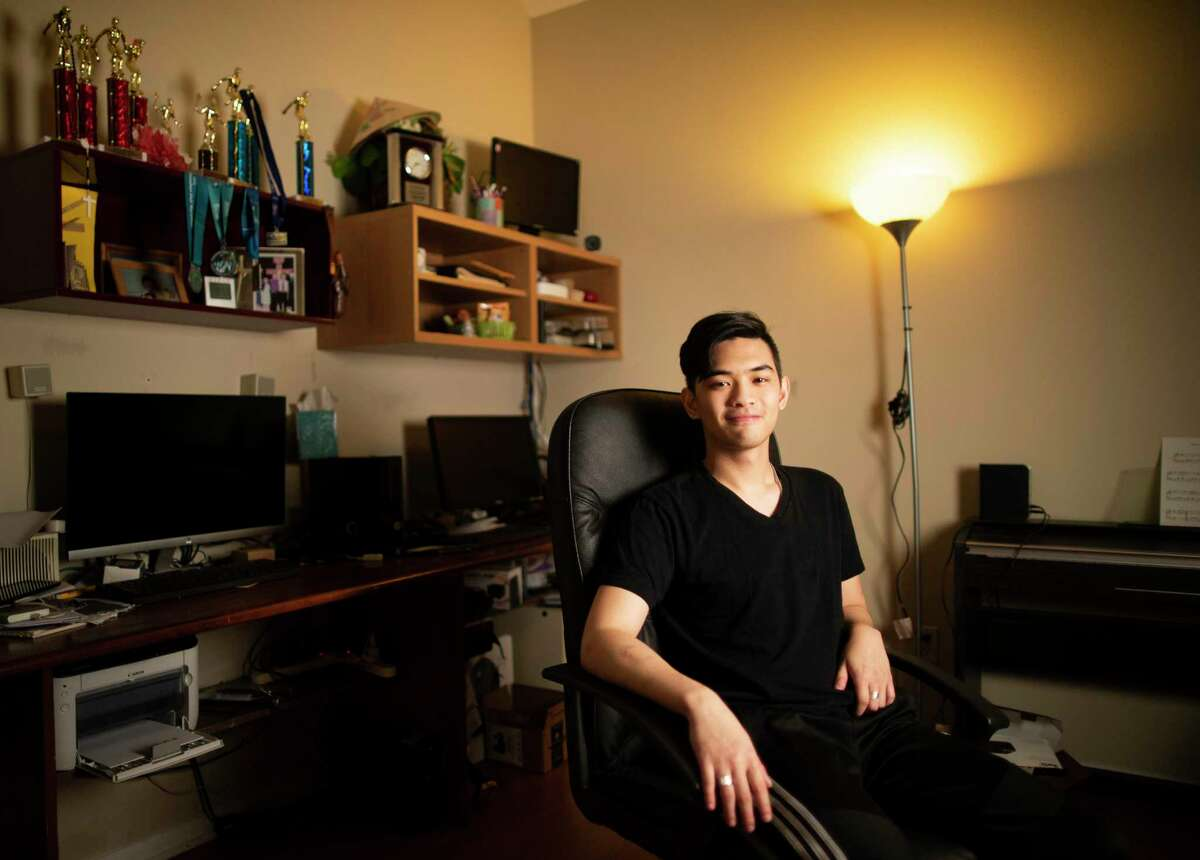 Rice University graduate Daniel Pham, 21, was offered a tech job in Seattle, but after the COVID-19 pandemic, the offer was revoked. He is now applying to jobs from his parents' house in the west side of Houston,shown Friday, May 15, 2020.