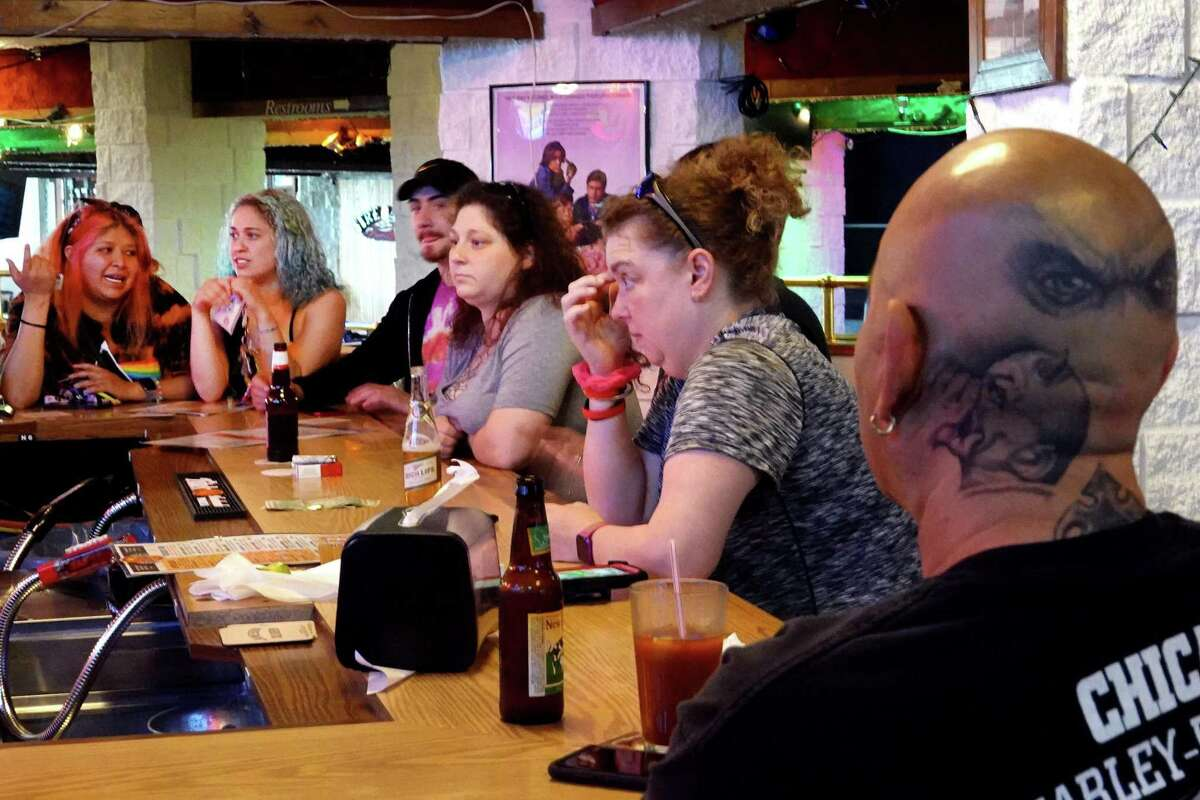 Customers eat and drink at the Brat Stop, a popular bar, restaurant and tourist attraction about 5 minutes from the Illinois border on Friday in Kenosha, Wisconsin. In a 4-3 decision, the Wisconsin Supreme Court o'verturned the state's stay-at-home order, deeming it
