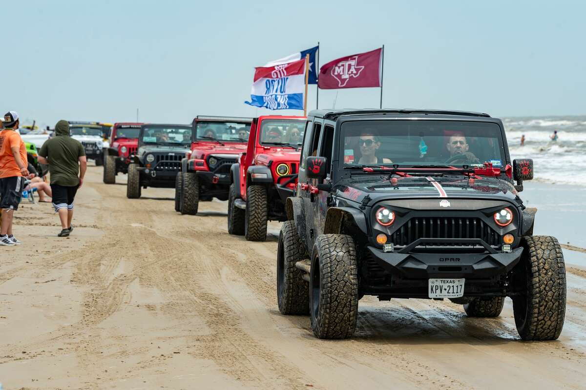 A parade of jeeps drives down the beach on Saturday. Jeep Weekend started as a small weekend event for Jeep lovers in Crystal Beach has grown to a large gathering of hundreds of vehicles including Jeeps, UTV's, 4-wheelers and more on the beach. Photo made on May 16, 2020. Fran Ruchalski/The Enterprise