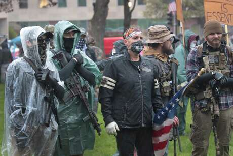 Armed demonstrators rally at the Michigan capital Thursday to protest the governor's stay-at-home order.