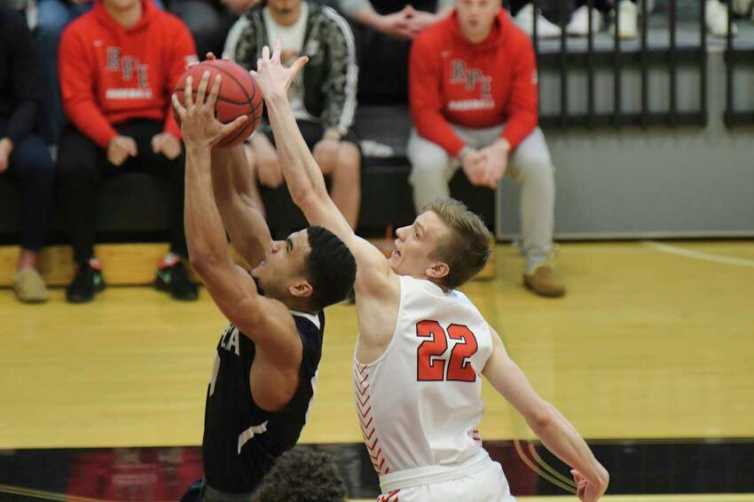 Mitchel Wayand, right, of RPI tries to grab a rebound during their game against Ithaca in the Liberty League men's basketball championship game on Sunday, March 1, 2020, in Troy, N.Y. (Paul Buckowski/Times Union)