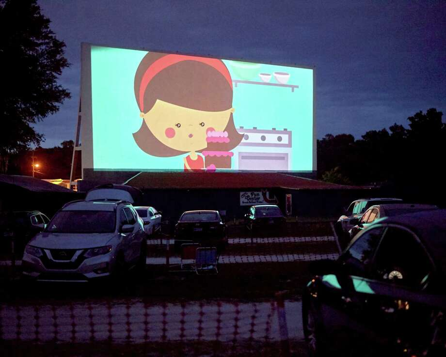 Movie-goers watch an animated short before the feature film at Ocala Drive-In Theater in Florida. Photo: Zack Wittman/Bloomberg / 2020 Bloomberg Finance LP