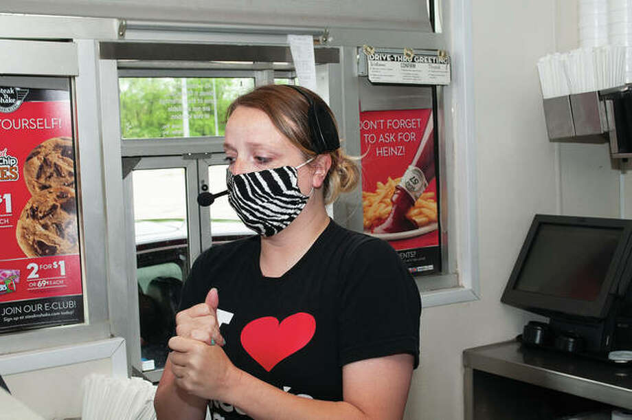 Katie McDannald, a waitress for Steak 'n Shake in Jacksonville, has been serving up some creative marketing during the COVID-19 pandemic by filming skits to help promote the restaurant's curbside service. Photo: Darren Iozia | Journal-Courier