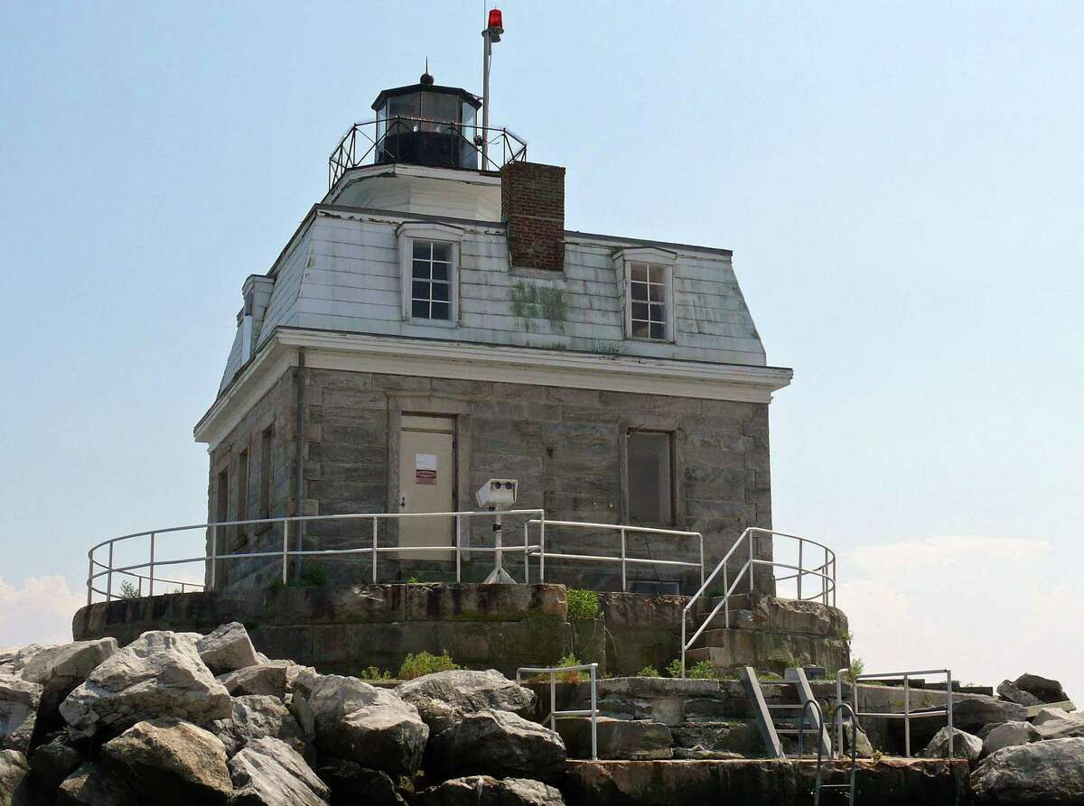 The town hopes it will be able to take possession of the Penfield Reef Lighthouse which has been put on the auction block.