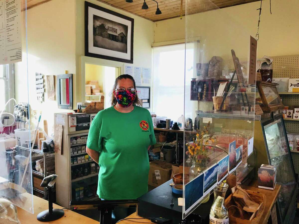 Wearing a mask and standing behind recently installed plexiglass panels, Bonnie Bloom has worked at the French Grocery in Marathon for the past four years.