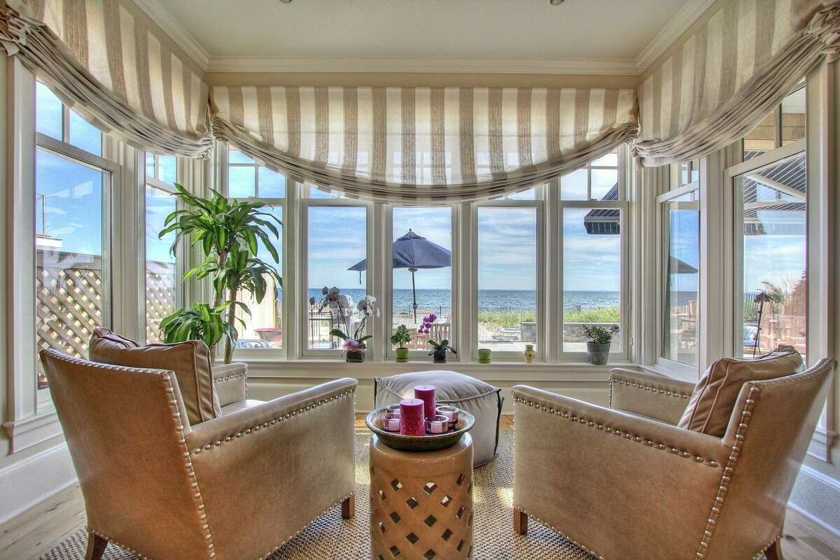 Conlan Segerson of Fairfield-based Tallman Segerson Builders utilized an alcove of tall, double hung windows in this sitting area to provide a relaxing spot in which to take in beautiful beach views for this client.