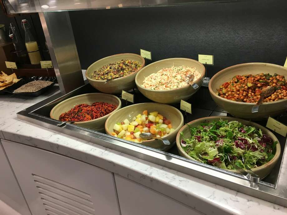 Disease prevention specialists warn germs can easily spread through the common serving utensils in buffet lines. Photo: Tim Jue/Courtesy