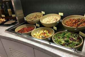 Disease prevention specialists warn germs can easily spread through the common serving utensils in buffet lines.