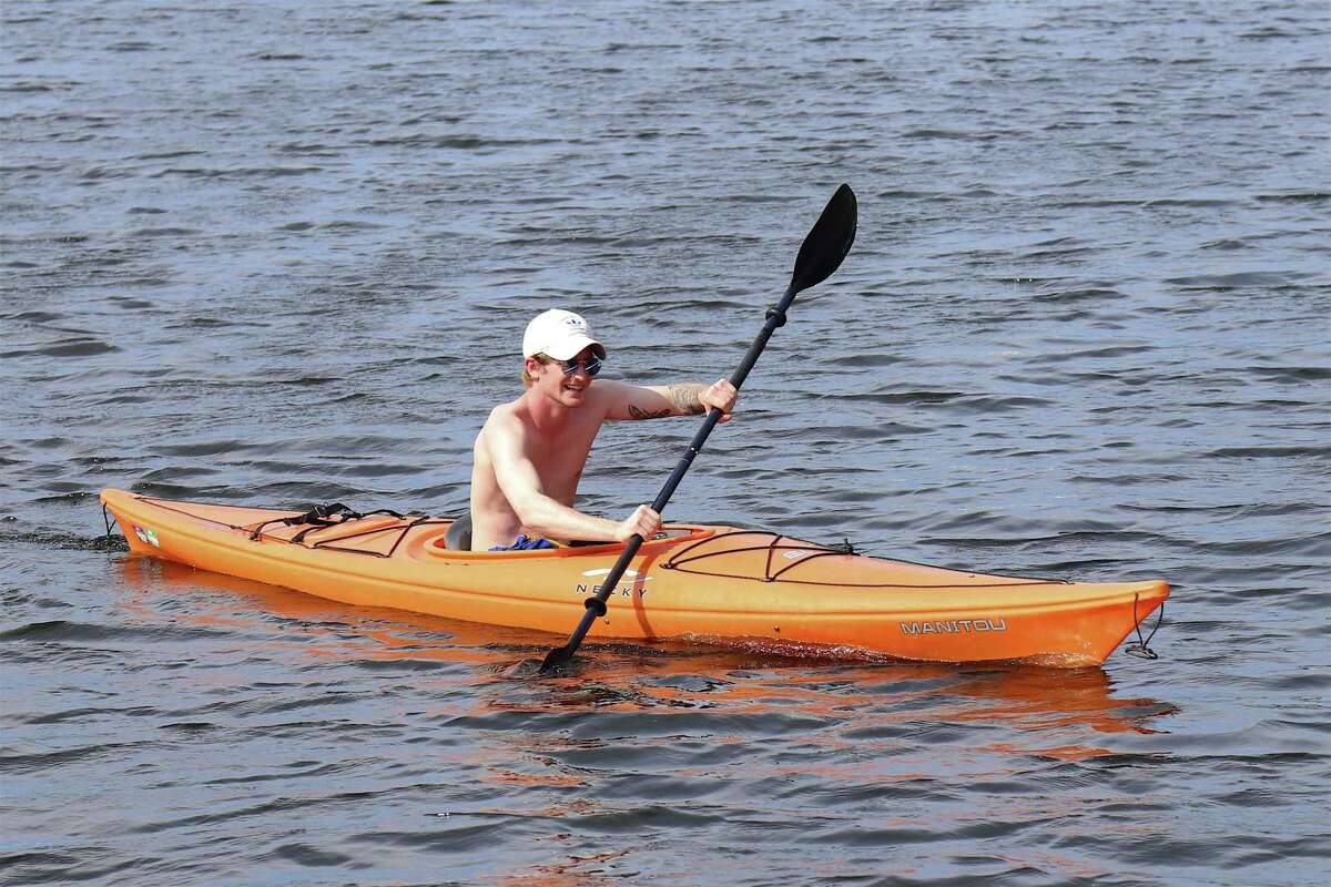 Jack Pomer of Fairfield does some paddling in Southport Harbor on Saturday, May 16, 2020, in Fairfield, Conn.