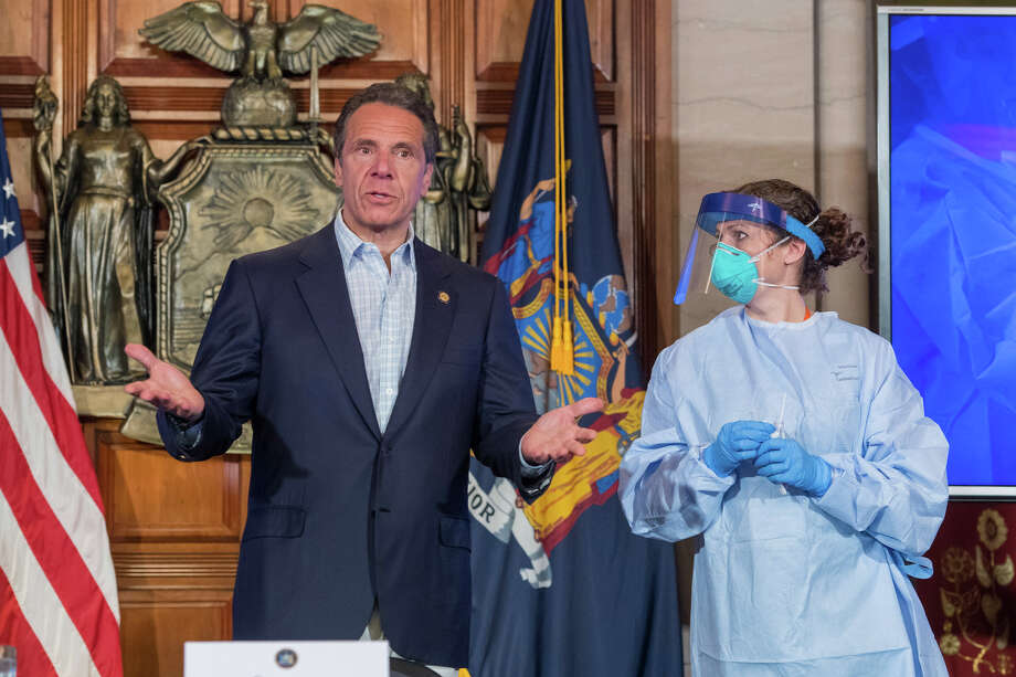 Gov. Andrew M. Cuomo is tested for COVID-19 during his daily coronavirus briefing on May 17, 2020. (Credit: Darren McGee/Office of Gov. Andrew M. Cuomo) Photo: Darren McGee/Office Of Gov. Andrew M. Cuomo / Office of Governor Andrew M. Cuomo