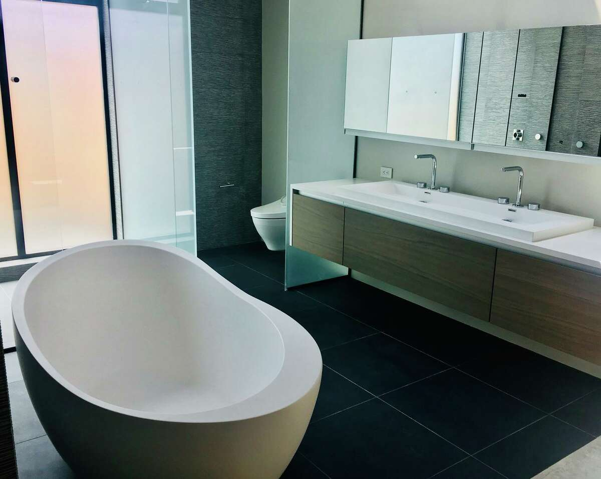 One of San Francisco-based interior designer David Mast's biggest design pet peeves is bathrooms whose commodes are immediately visible upon entering the room. This spa bathroom in Campbell utilizes a partition for privacy.